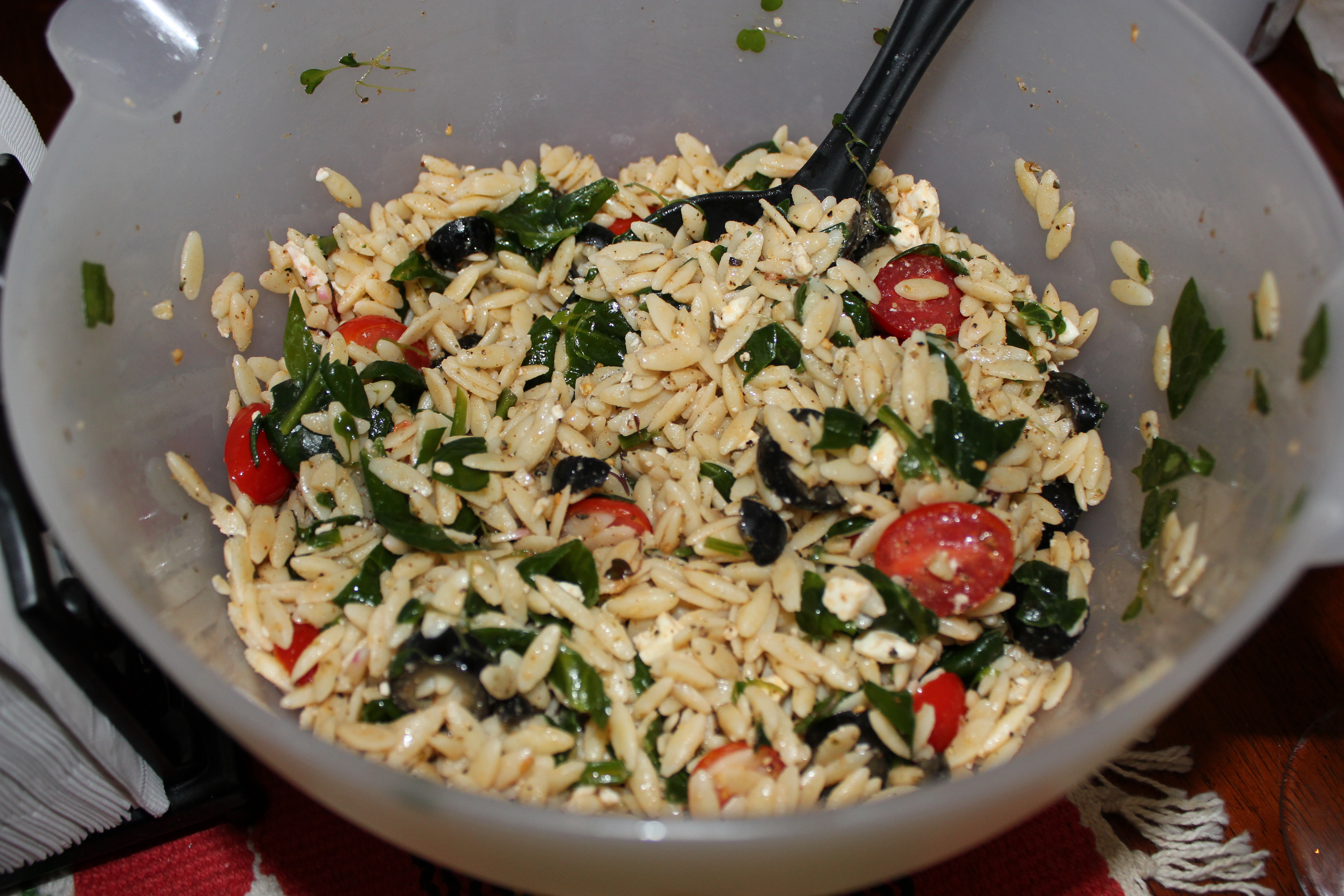 Orzo Salad with Cherry Tomatoes, Olives, Greens, Feta Cheese and Olive ...